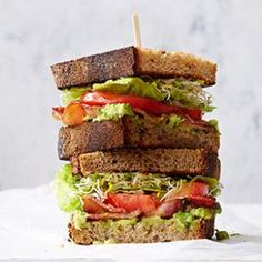In this healthy BLT recipe, we use a creamy avocado spread flavored with garlic and basil, and add sprouts.