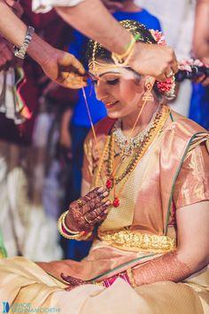 South Indian bride. Temple jewelry. Jhumkis.Gold silk kanchipuram sari.Braid with fresh flowers. Tamil bride. Telugu bride. Kannada bride. Hindu bride. Malayalee bride.