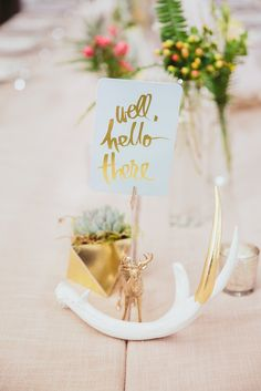 """Gold-Dipped Antler Decoration and """"Well, Hello There"""" Paper Sign with Gold Lettering 