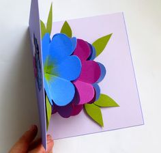 mmmcrafts: made it: Martha Stewart pop up flower card Video: 2:05 mins  easy, handmade pop-up card for mom I watched this video about one thousand times to try and decipher the way you adhere the finished flowers together. I really like her voice! In the end, the written tutorial was the most helpful for that, so I recommend you use both their video and the written tutorial. Just keep in mind each flower will be tacked in three places, except for the middle flower which is tacked on every…