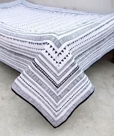 A beautiful black and white Aztec quilted bedspread.  This quilted bedspread is made of fine quality cotton fabric with cotton wadding and then lined