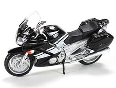 This Yamaha FJR 1300 Diecast Model Motorcycle is Black and features working steering, wheels. It is made by Maisto and is 1:18 scale (approx. 11cm / 4.3in long).  ...