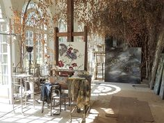 French artist Claire Basler lives and paints in her home Château de Beauvoir where she creates huge paintings of flowers.