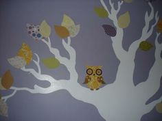 Tree Mural with Baby Owls Perched in the branches above the Babys Crib