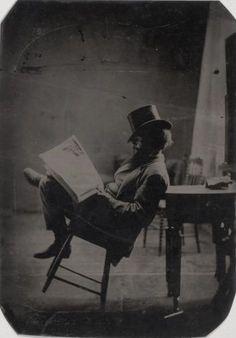 ca. 1880, portrait of a gentleman reading the newspaper
