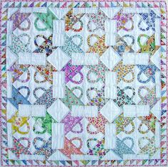 Link isn't active but I liked the colors she used. Postage Stamp Basket Doll Quilt.