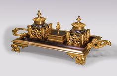 A large mid 19th Century bronze and ormolu Pentray, having central compartment flanked by pagoda lidded glass inkwells, contained in Gothic fretwork holders. The Pentray having leaf and berry scrolled handles, supported on foliate feet. Circa: 1850 Ref: 5632