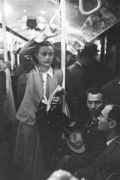Some things never change....She's standing in heels, no doubt. They're sitting. Is she also pregnant? Wouldn't be any different. Been there, sister.  Stanley Kubrick shoots the N.Y.C. subway, 1946 | Dangerous Minds