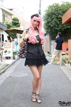 Too Cute! I love pink hair! My hair is brighter than hers. I can't wait for it to lighten to that color!