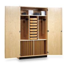 art supplies storage: Cabinet with pull out drawers and vertical storage for canvases. I could go for something like this :)