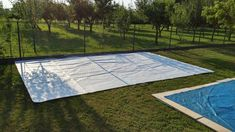 the DIY pallet garden party lounge / deck and patio furniture, installed on a green garden carpet and is having a also a swimming pool in sides, an ever best