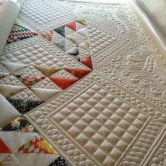 Wow! Look at this beautiful quilting! Love the textures and how the stitching is featured!