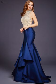 Jovani 29351 Beautiful sleeveless mermaid dress features a high neckline and tiered skirt.