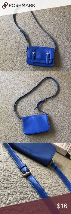 Cobalt blue crossbody purse This adorable purse is perfect for those movie dates or coffee outings. The inside has black and white polka-dot pattern with a zipper pocket. It also has another pocket on the outside that perfectly fits your IPhone. Purchased from Forever 21 and in excellent condition. Forever 21 Bags Crossbody Bags