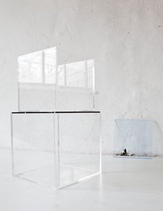 Looking desperately for wall-mountable transparent plexiglass cube shelves for above our bed...