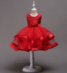Your little diva look too gorgeous in this elegant red dress. The combination of pearl on the neckline, cute bow on waistline and embellishment of red ribbon on the hemline highlight the dress which make this dress more exquisite. Baby Birthday Dress, Baby Girl Party Dresses, Girls Formal Dresses, Birthday Dresses, Little Girl Dresses, Baby Dress, Flower Girl Dresses, Girl Birthday, Lila Baby