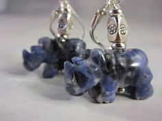 Wonderful blue and white rhinos with great detail and leverback findings so they do not charge out of your ears. The lovely blue…