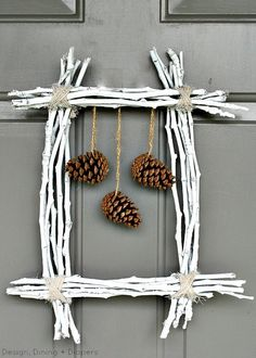 Pine Cone and Twig Wreath by Design, Dining + Diapers - I can see this with hanging hearts for a February wreath....