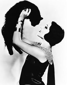 Black kitteh with Delores del Rio, circa late 1920s