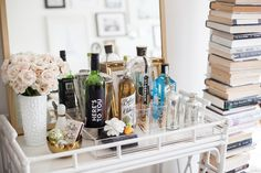 Styled bar cart & vertical book shelves | Alaina Kaczmarski's Lincoln Park Apartment Tour #theeverygirl