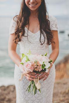 A romantic blush rose bridal bouquet | @evynnlevalley | Brides.com