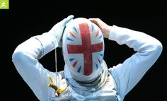 A member of the Great Britain fencing team, Sophie Troiano, prepares for her event Photograph: David Levene for The Guardian