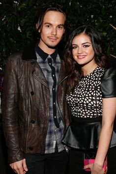 Actors Tyler Blackburn (L) and Lucy Hale attend the Celebration of NYLON's December/January Cover Star Lucy Hale Presented by bebe at Andaz Hotel on December 7, 2012 in Los Angeles, California.