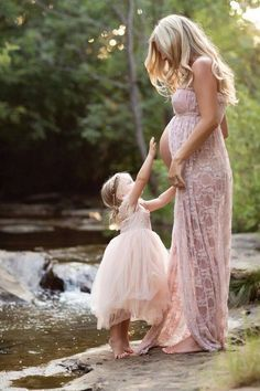 Elegant hand made vintage style lace gown with ruffle trim. This beauty also has the convenience of off the shoulder detachable sleeves. In order to showcase your baby bump, this stunning gown comes s