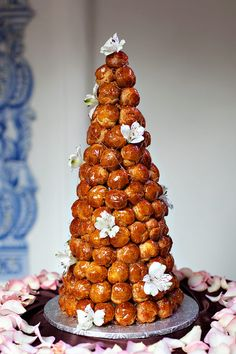 This is a French wedding cake called a Croquembouche, and I want a pair of them as floaters at my wedding.