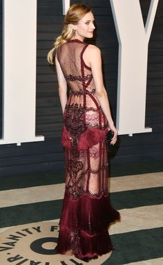 in a sheer, beaded and fringe Reem Acra gown worn with Sylva & Cie jewels and Jimmy Choo accessories (2016)