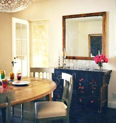 Love the huge mirror above cabinet. Love for the dining room