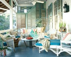 Old shutters bring vintage cool to this coastal patio.
