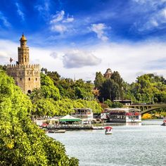 """Al-Andalus ( الأندلس ) - The Torre del Oro (English: """"Tower of Gold"""") is a military watchtower in Seville, southern Spain, built by the Almohad dynasty in order to control access to Seville via the Guadalquivir river. The Tower of Gold was built 1220-1221, by order of the Almohad governor of Seville, Abu l-Ulà, It is one of two anchor points for a large chain that would have been able to block the river. The chain was used in the city's defense against the Castilian fleet."""