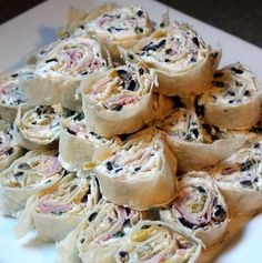 Tortilla Roll-ups Recipe - cream cheese, chiliis, olives and ham.  Classic!