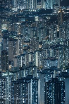 High density of hong kong residential district at night by Vorrarit. Please Like http://fb.me/go4photos and Follow @go4fotos Thank You. :-)