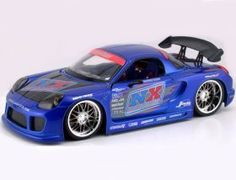 This Toyota MR2 Spyder Diecast Model Car is Blue and features working steering, wheels and also opening bonnet with engine, boot, doors. It is made by Jada and is 1:18 scale (approx. 25cm / 9.8in long). ...
