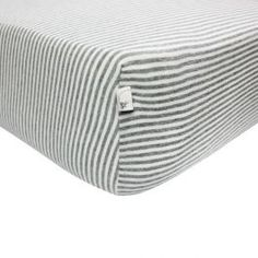 GOTS certified organic cotton Burt's Bees Baby® fitted crib sheets for a warm, soft, comfortable sleep. The fully-fitted BEESNUG™ premium elastic and soft jersey knit fabric stretches to fit all standard mattresses. Stripe patterned for cute modern boy