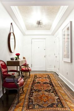 Persian rugs color your entry. warms a narrow, cold space.