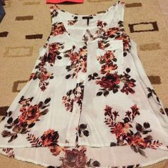 Beautiful floral tank Baby blue and floral button down tank with pockets. Slightly longer in back. Excellent condition!  Nollie Tops Tank Tops