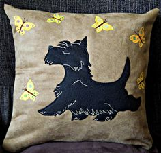 This stylish handmade appliqued cushion/pillow cover features a perky Scottish…