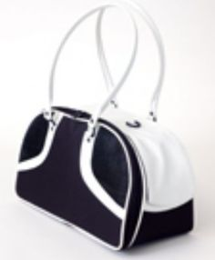 ROXY Black & White Pet Carrier from   SimplyDogStuff.com is a handbag style pet tote of distinctive fashion, $120-140.