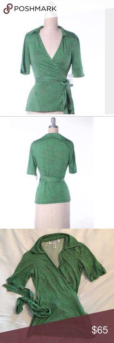 Diane von Furstenberg (DVF) Green Heart Wrap Shirt Diane Von Furstenberg (DVF) wrap shirt in Green Heart print.  Size 0.  Barely worn.  A timeless Classic!!!  100% Silk.  A must buy!!!! Diane von Furstenberg Tops Blouses
