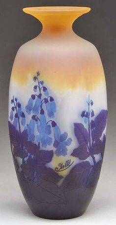 IMAGE: A Galle Cameo vase having a rare square shape with strongly colored blue and purple bellflowers against a shaded deep amber to frosted background