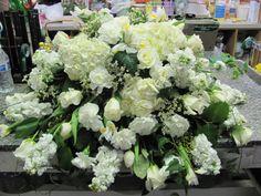 All white casket spray.