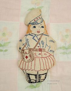 Downloadable patterns for vintage embroidered dolls.