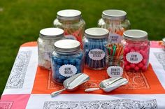 The candy jars are a fun idea, but it is the table cloth I like.  I actually had this idea a while back but have not acted on it yet.  This inspires me to get it together.  :-)