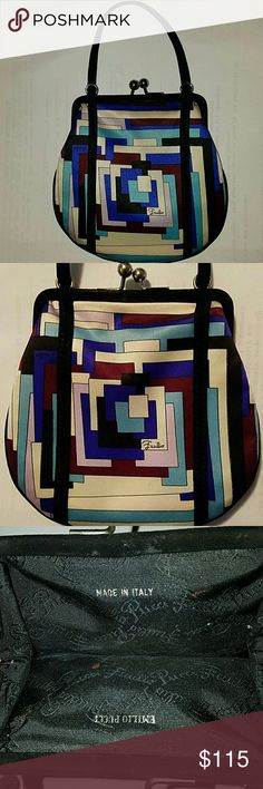 Authentic Pucci Wristlet This divinely little evening clutch is big enough for all your evening-out needs. It measures 5.5x5.5 inches. Emilio Pucci Bags Mini Bags