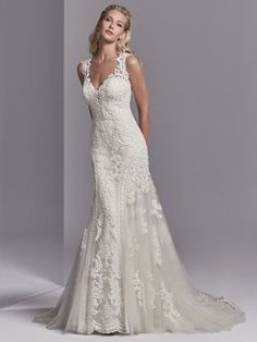Sottero and Midgley Channing Rose - This wedding dress features striking lace motifs accented in beading atop tulle. Embroidered lace borders the tulle on either side of the fit-and-flare skirt. Featuring an illusion plunging sweetheart neckline, illusion Western Wedding Dresses, Luxury Wedding Dress, Sexy Wedding Dresses, Princess Wedding Dresses, Perfect Wedding Dress, Wedding Dress Styles, Bridal Dresses, Wedding Gowns, Sottero And Midgley Wedding Dresses