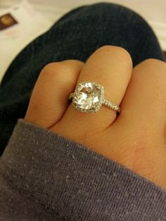 My custom engagement ring! SO happy!  It's a 3 carat round cut cushion halo platinum wedding ring with a thin 1.8mm diamond band. Classic and beautiful :)