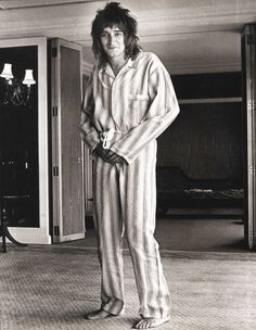 """Rod Stewart. London.1974.  Rod Stewart was apparently sick of """"cheesecake"""" publicity shots, so when Dickson arrived at the Royal Garden Hotel one morning to do the photo session, the singer mischievously climbed into a pair of pajamas his mother had recently bought for him.  © Ian Dickson."""